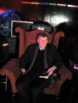 11. Alan Bennett in stately chair backstage